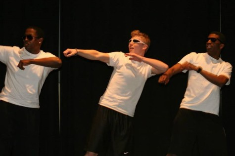 New members of Alpha Phi Delta perform onstage during Airband.