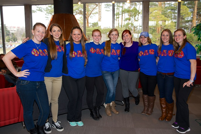Phi Lamda Psi sisters pose together at their Spaghetti Dinner.