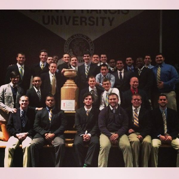 Sigma Chi poses with the Greek Week trophy at the closing ceremony.