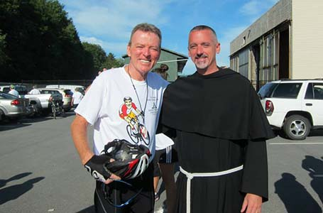 Bro. Shamus McGrenna (left) biked 550 miles this summer to raise money for the Dorothy Day Center.