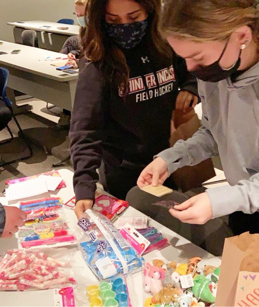 Field Hockey Players Share Valentine's Day Wishes with Cambria Care Center Residents