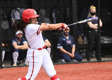 Rousseau Helps Power Softball Squad to First Place in NEC