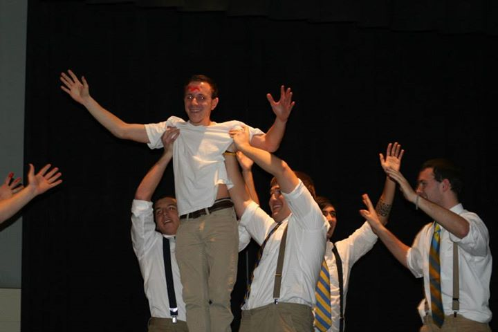 New+members+of+Sigma+Chi+hoist+New+Member+Educator+Evan+Anthony+as+part+of+their+Airband+performance.